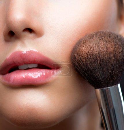 Make-up closeup. Cosmetic Powder Brush. Perfect Skin