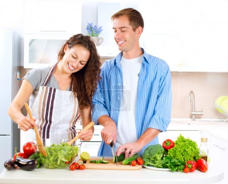 Photo for Happy Couple Cooking Together. Dieting. Healthy Food - Royalty Free Image