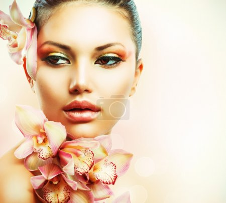 Photo for Beautiful Girl With Orchid Flowers. Beauty Woman Face - Royalty Free Image