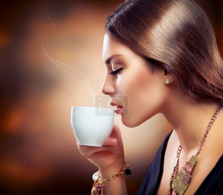 Photo for Beautiful Girl Drinking Tea or Coffee - Royalty Free Image