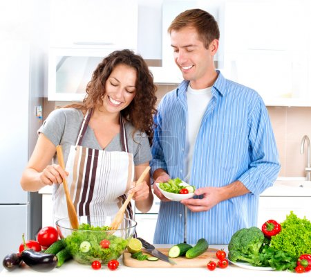 Young Couple Cooking Vegetable Salad Together