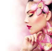 Beautiful Girl With Orchid Flowers. Perfect Make-up