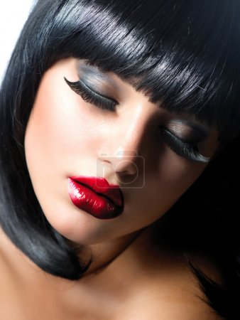 Sexy Woman. Brunette Girl with Extreme Makeup. Vamp Style