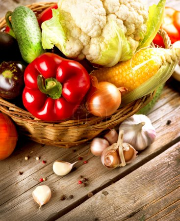 Healthy Organic Vegetables on the Wooden Background
