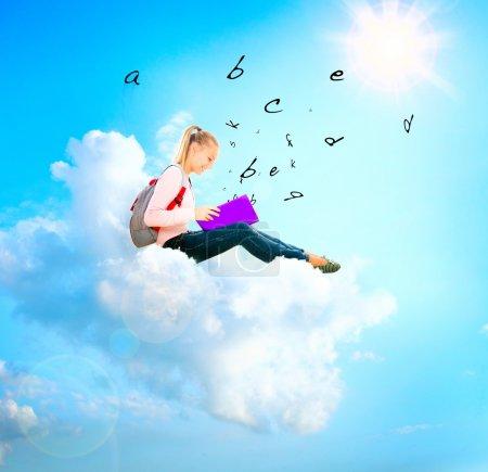 Photo pour School Girl or Student on a Cloud Lecture d'un livre. Éducation - image libre de droit