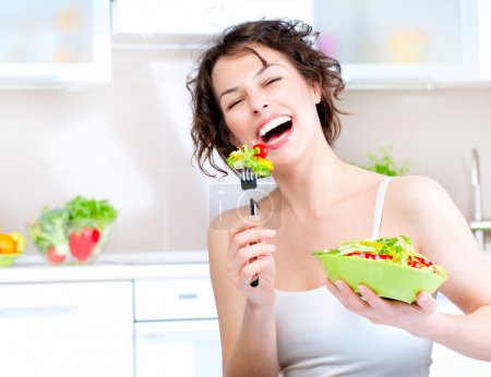 Photo for Diet. Beautiful Young Woman Eating Vegetable Salad - Royalty Free Image