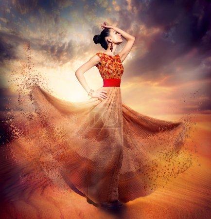 Photo for Dancing Fashion Woman wearing Blowing Long Chiffon Dress - Royalty Free Image