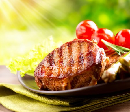 Grilled Beef Steak BBQ. Barbecue Meat Steak outdoor with Vegetab