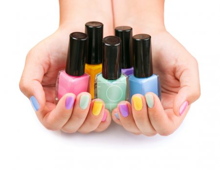 Nail Polish. Manicure. Colored Nail Polish Bottles in the hands