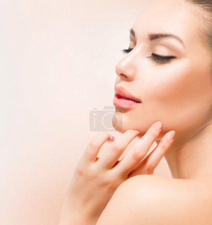 Spa Girl. Beautiful Young Woman Touching Her Face