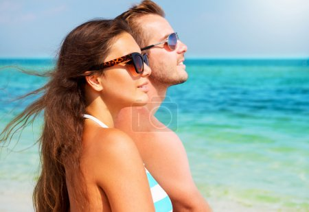 Photo for Happy Couple in Sunglasses on the Beach. Summer Vacation - Royalty Free Image