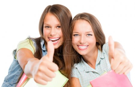 Students Portrait. Cute Attractive Teenage Girls Holding Books