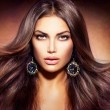 Glamour Beautiful Woman with Blowing Brown Hair...