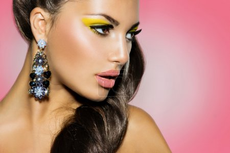 Fashion Model Girl over Pink Background. Creative Makeup