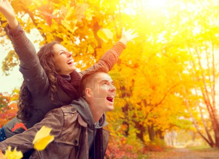 Photo for Happy Couple in Autumn Park. Fall. Family Having Fun Outdoors - Royalty Free Image