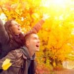 Happy Couple in Autumn Park. Fall. Family Having F...