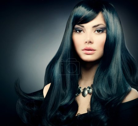 Photo for Brunette Luxury Girl. Healthy Long Black Hair and Holiday Makeup - Royalty Free Image