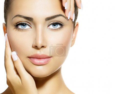 Photo for Beauty Portrait. Beautiful Spa Woman Touching her Face - Royalty Free Image