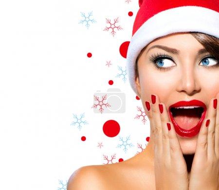 Christmas Woman. Beauty Model Girl in Santa Hat