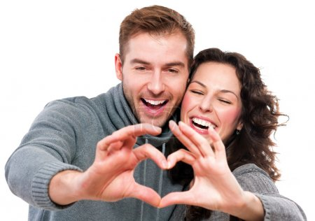 Photo for Valentine Couple Making Shape of Heart by their Hands - Royalty Free Image