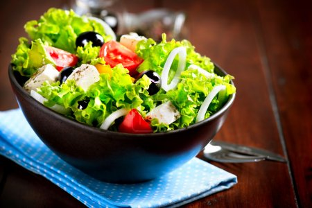 Photo for Greek Salad Bowl with Feta Cheese, Tomatoes and Olives - Royalty Free Image