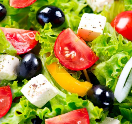 Photo for Greek Salad closeup with Feta Cheese, Tomatoes and Olives - Royalty Free Image