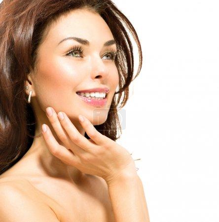 Beauty Woman. Beautiful Young Female touching Her Skin
