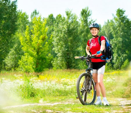 Young woman riding bicycle outside
