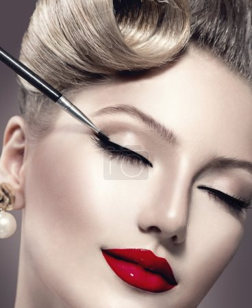 Makeup. Vintage style make-up applying closeup. Ey...