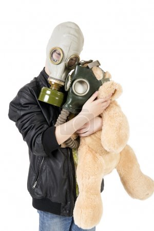 Child with a toy in gas mask