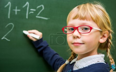 Child at school, girl in school working with abacus