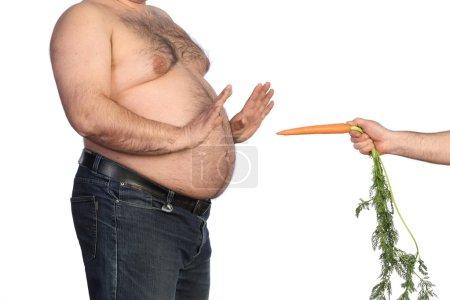 Fat man holding carrot