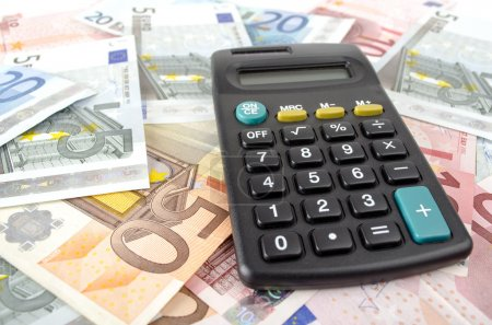 calculator and euro banknotes