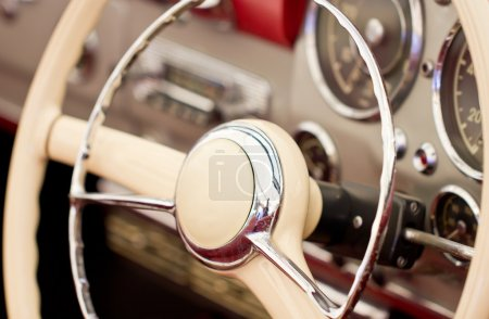 Steering wheel on classic car.