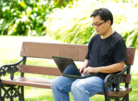 Asian man working with laptop