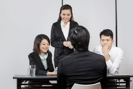 Asian colleagues interview an applicant.