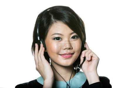 Chinese Business woman wearing a headset.