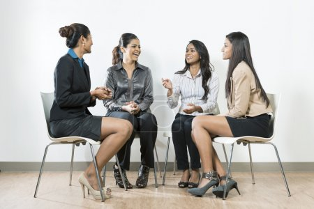 Photo for Group of Indian business women having a conversation - Royalty Free Image