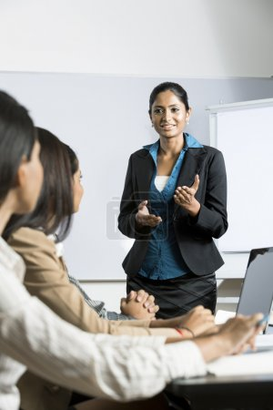 Indian businesswoman giving a presentation