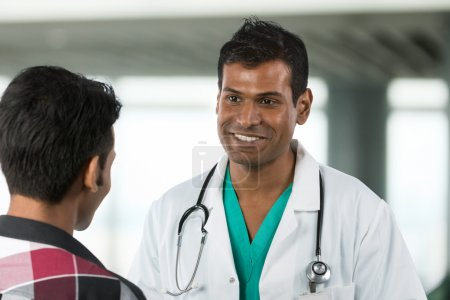 Indian Doctor talking a patient.