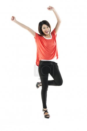 Full length portrait of a pretty Chinese woman celebrating.