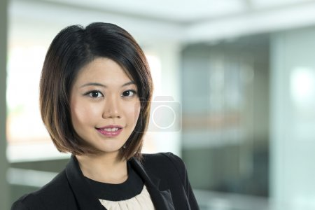 Close up of happy Chinese business woman.