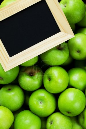 Green apples and a chalk board