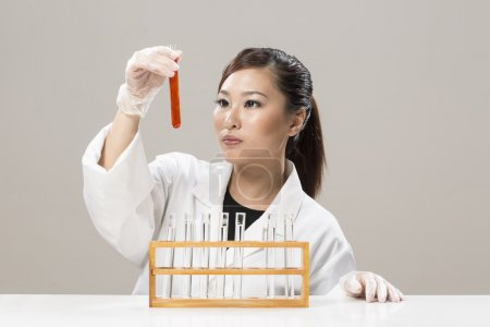 Chinese Female scientist handling chemicals