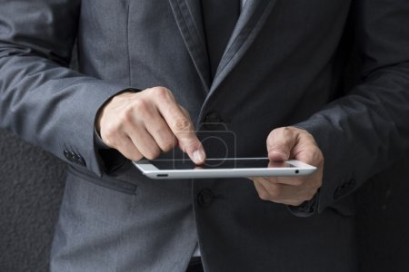 Closeup of a Chinese man with a tablet computer.