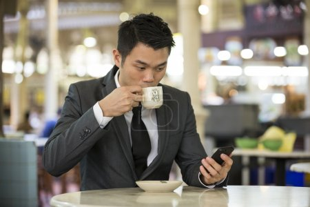 Businessman in a cafe drinking coffee