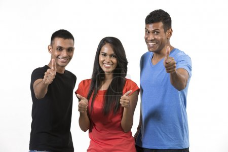 Photo for Happy group of Indian friends with thumbs up. isolated over white background. - Royalty Free Image