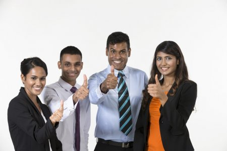 Team of happy Indian business people with Thumbs Up