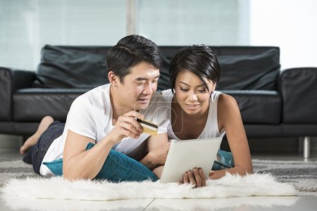 Asian couple at home Shopping Online