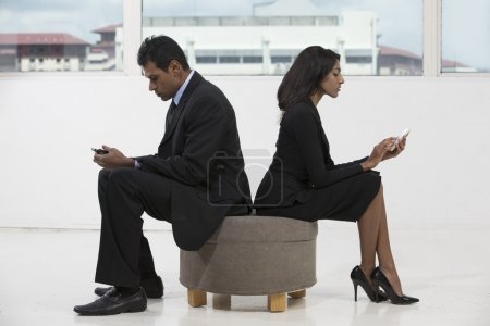 Indian business colleagues using smart phones